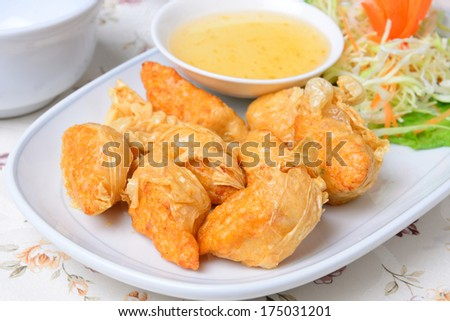 chinese food name Deep fried shrimp rolled on white dish