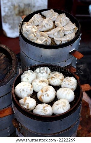 Chinese food of dumpling, and chinese people called it Jiaozi, they eat Jiaozi expressing meaning of lucky and happy