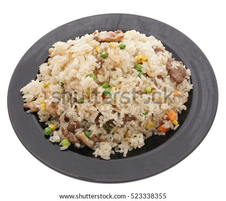 Chinese food. Rice with chicken pork and veal with vegetables in black plate isolated on white. Closeup.