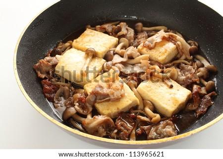 Chinese food, Shimeji Mushroom and Tofu stir fried on fry pan - stock photo
