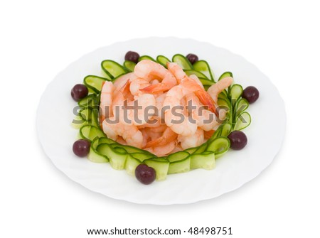 Chinese food. Shrimps decorated with sliced cucumbers and cherries.