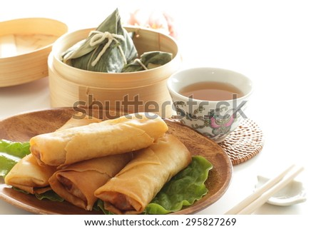 Chinese food, spring roll and steamer dim sum - stock photo