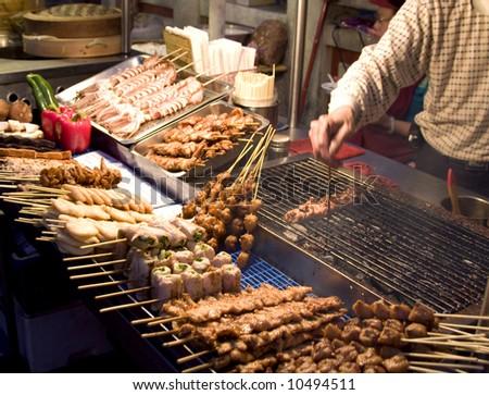 Chinese food vendor market - stock photo