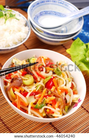 chinese food with various vegetables and rice