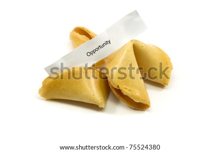Chinese fortune cookies cracked open with the fortune opportunity written on it. - stock photo