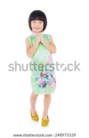 Chinese girl in greeting gesture. Chinese new year concept. - stock photo