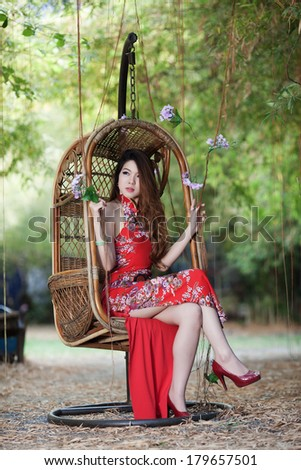 Chinese girl in traditional Chinese cheongsam blessing - stock photo