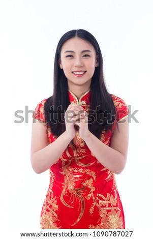 Chinese girl traditional chinese cheongsam greeting stock photo chinese girl in traditional chinese cheongsam greeting isolated on white background m4hsunfo
