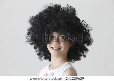 chinese girl wearing a big black wig - stock photo