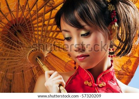 Chinese girl with parasol wearing a cheongsam