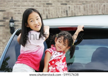 Chinese girls before car