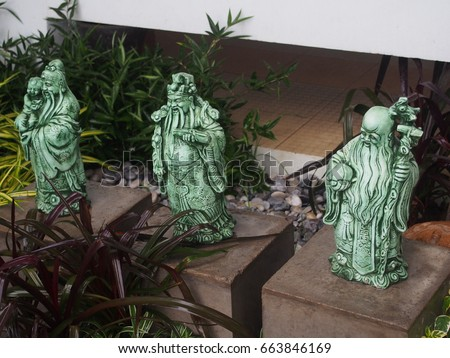 Chinese god of fortune, prosperity and longevity figurine called three goddesses Fu Lu Shou in the small garden