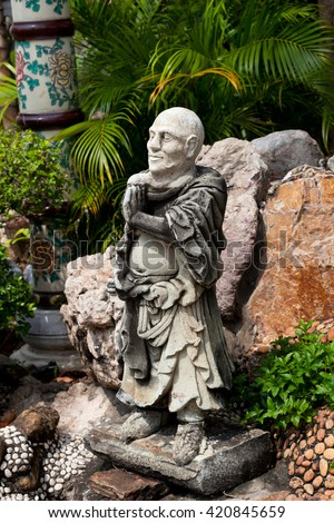 Chinese god sculpture in the garden of Wat Pho - stock photo