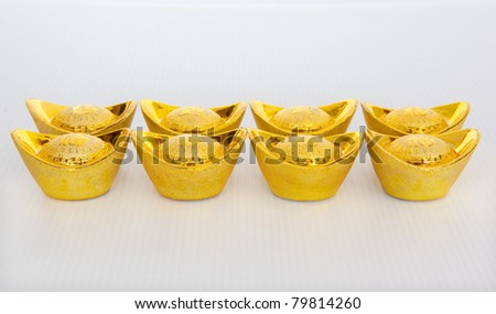 Chinese gold ingot ornaments in isolated white background - stock photo
