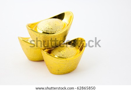 Chinese gold ingot ornaments isolated on white background. The characters on gold ingot means Making plenty of money . - stock photo