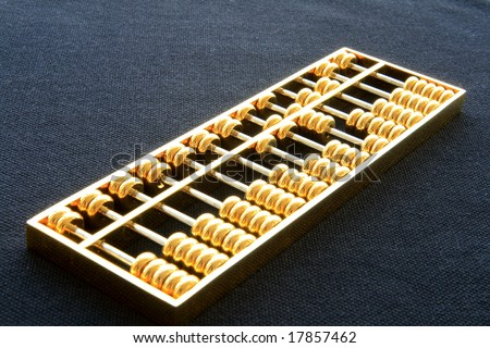 chinese golden abacus - stock photo