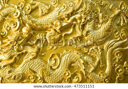 Chinese golden dragon at the wall.