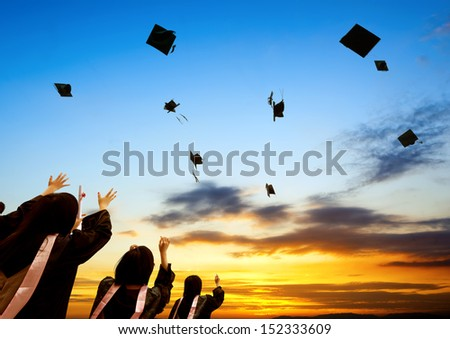 Chinese graduates and sunset sky. - stock photo
