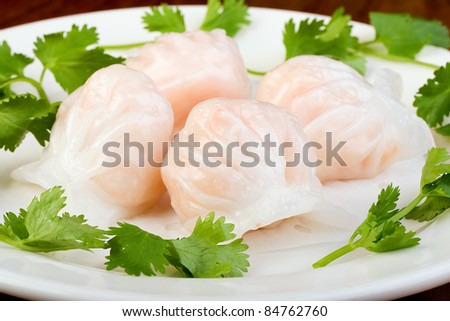 Chinese Har Gao Dim Sum dumplings in the shape of a bonnet. - stock photo