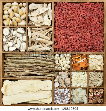 Chinese herb medicines in a rustic wooden box - stock photo