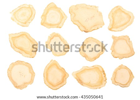 Chinese Herbal medicine - American Ginseng slices (Panax quinquefolius) on white background (manual focus)