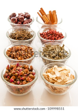 Chinese herbal medicine and flower tea in glass cups on white background. - stock photo
