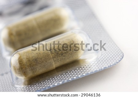Chinese herbal medicine capsules, closeup shot with selective focus. - stock photo