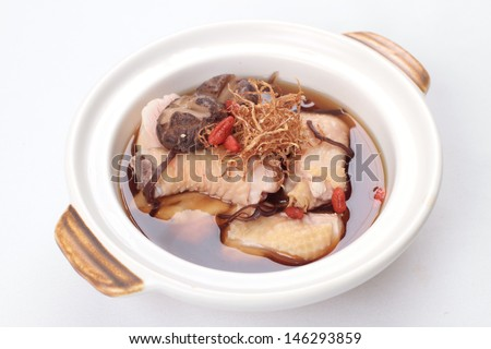 Chinese herbal soup with meat in clay pot