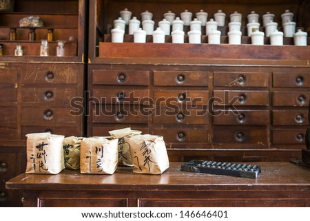 Chinese herbs used in placing the jars and drawers, wrapping paper on the font is medicine's name - stock photo
