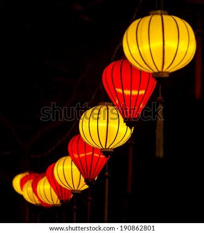 Chinese illuminated yellow and red lanterns - stock photo