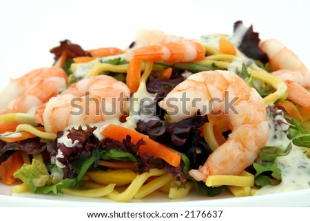 Chinese King prawn shrimp salad, with noodle, peppers, lettuce and sauce on white, macro, closeup