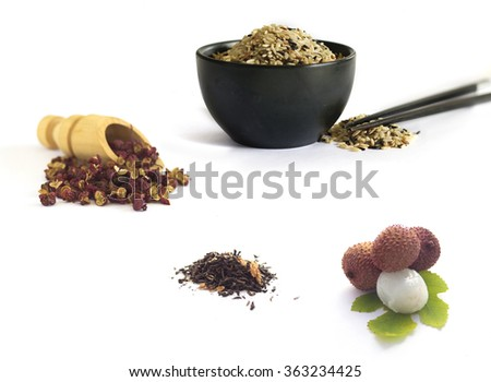 Chinese kitchen  rice, tea, Lychee and spices isolated on white - stock photo