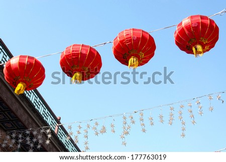Chinese lantern in the sky. Located in the Tianjin Ancient Culture Street, Tianjin City, China. - stock photo
