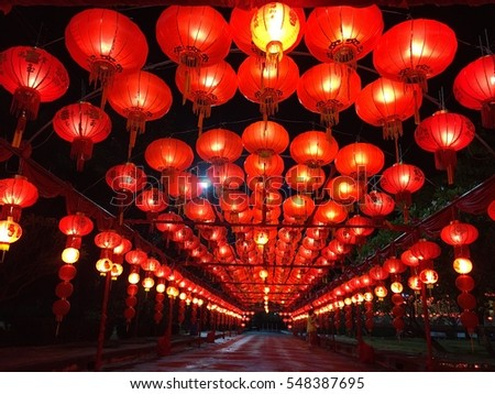 Chinese lanterns aglow at night as part of a festival.