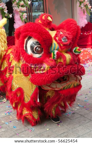 chinese lion dance at new year day outdoor. - stock photo