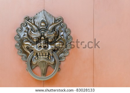 Chinese lion door knob at the left
