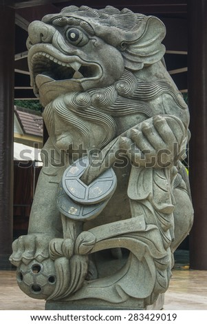 Chinese Lion guard statue. taken at the entrance of temple in Thailand. - stock photo