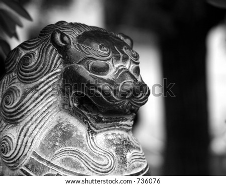 chinese lion head statue - stock photo