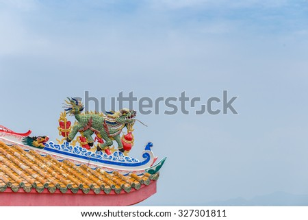 Chinese lion on the roof - stock photo