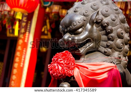Chinese lion statue in front of chinese temple