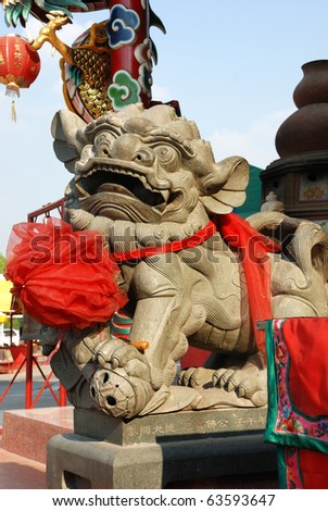 chinese lion statue usually front of gates and for good luck