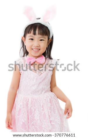 Chinese Little Girl in banny costume on plain white isolated background.