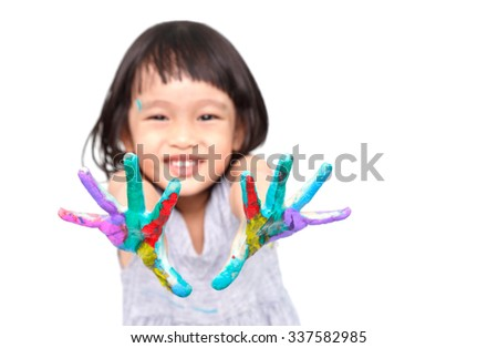 chinese little girl with hands in the paint - stock photo