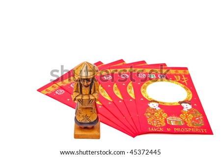 Chinese Lucky Money Envelopes with figurine isolated on white - stock photo