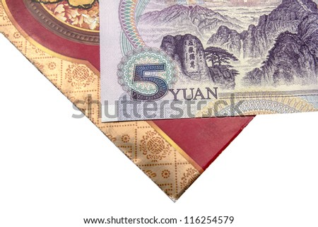 Chinese lucky money red envelope and Yuan closeup - stock photo