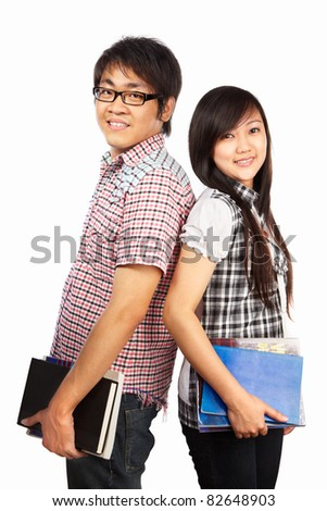 Chinese male and female students holding book, isolated on white background - stock photo