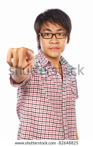 Chinese male young adult pointing his index finger to camera, isolated on white background - stock photo
