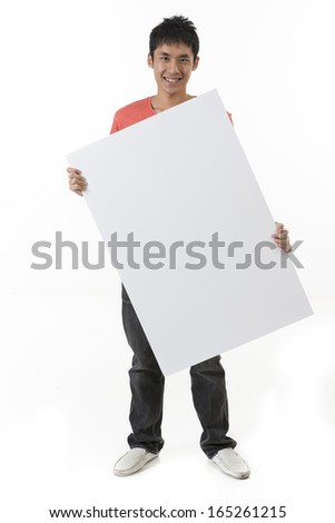 Chinese man holding up a banner against a white background. Cardboard placard is blank ready for your message.