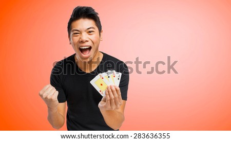 chinese man playing poker - stock photo