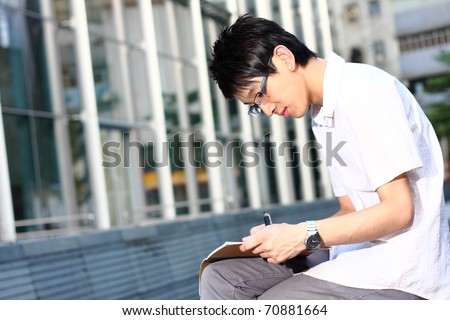 chinese man studing outdoor at day - stock photo